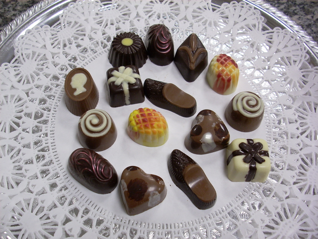 Picture: White doiley on a plate with about a dozen different pieces of yummy-looking chocolate