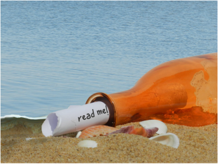 Picture: Bottle washed up on a beach with a note sticking out that says,
