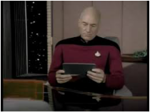 Picture: Capt. Picard reads from an tablet. catmichaelswriter.com