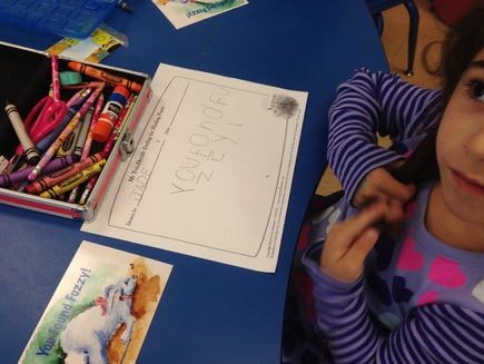 Tips for KidLit Author School Visits_Young girl draws picture about author visit story