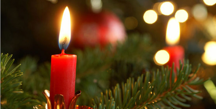 Picture: Red candles glowing in branches of a fir tree